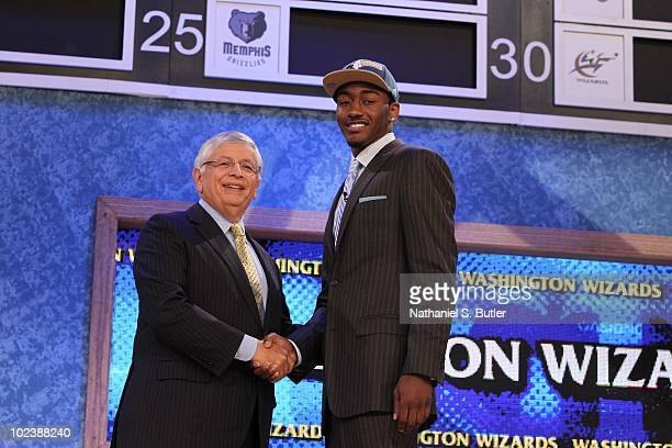 John Wall shakes hands with NBA Commissioner David Stern after being selected number one overall by the Washington Wizards during the 2010 NBA Draft...