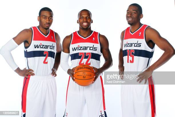 John Wall, Shelvin Mack and Jordan Crawford of the Washington Wizards pose for a portrait during 2011 NBA Media Day at the Verizon Center on December...
