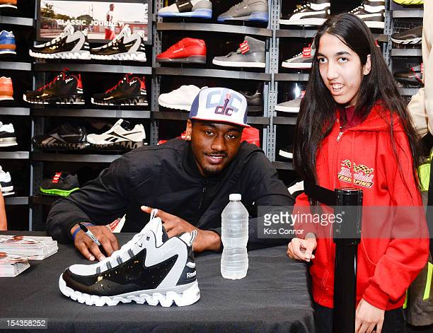 3e6aac0eff3e John Wall signs autographs and poses with fan during the Reebok s Launch of  John Wall s Season