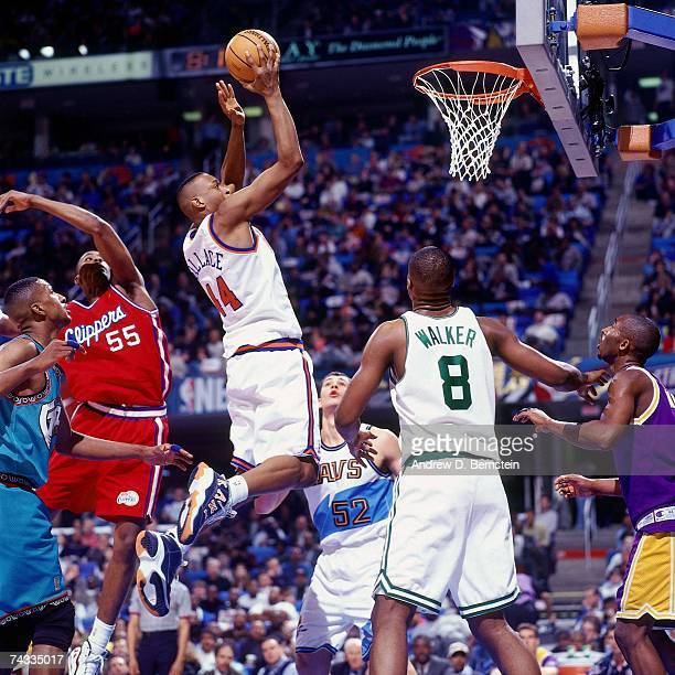 John Wallace of the Eastern Conference attempts a layup against Lorenzen Wright of the Western Conference during the 1997 Rookie Game played February...