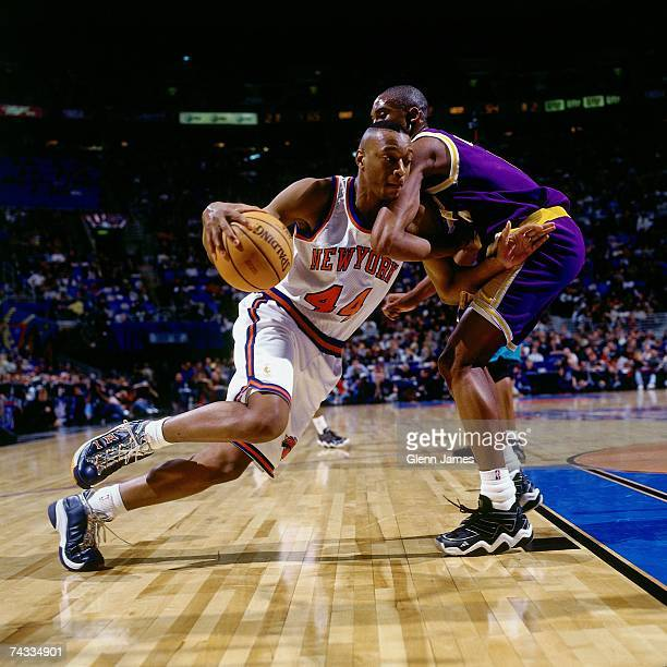 John Wallace of the Eastern Conference drives to the basket against Kobe Bryant of the Western Conference during warmups before the 1997 Rookie...