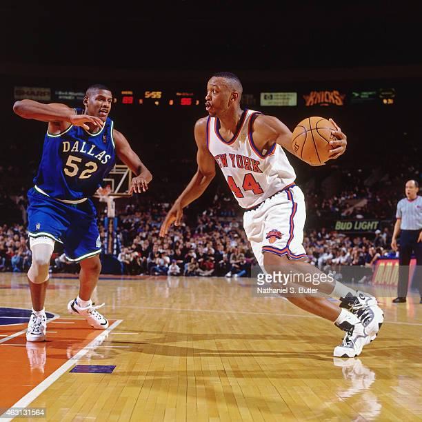 John Wallace of the New York Knicks drives against Samaki Walker of the Dallas Mavericks on January 7 1997 at Madison Square Garden in New York City...