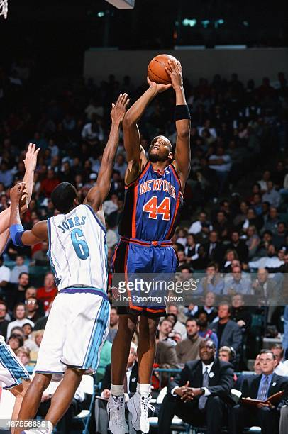John Wallace of the New York Knicks takes a jump shot against Eddie Jones of the Charlotte Hornets during the game on February 7 2000 at Charlotte...
