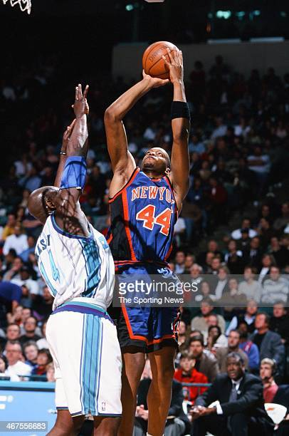 John Wallace of the New York Knicks takes a jump shot during the game against the Charlotte Hornets on February 7 2000 at Charlotte Coliseum in...