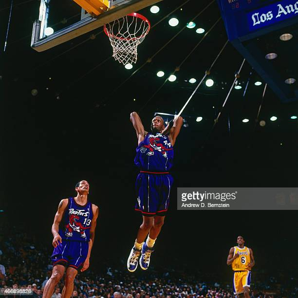 John Wallace of the Toronto Raptors dunks against the Los Angeles Lakers on November 30 1997 at The Forum in Inglewood California NOTE TO USER User...