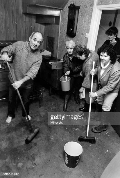 John Walsh and his family clear up at Mill House Fishguard More than 20000 householders were under orders to boil all drinking water after supplies...
