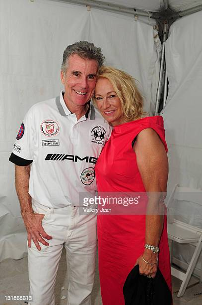John Walsh and Reve Walsh backstage after Meghan Walsh Blank Silk fashion show at the AMG Miami Beach Polo Cup VII kick off on April 21 2011 in Miami...