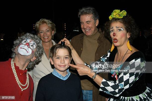 John Walsh wife Reve and son Hayden have some fun with clowns Grandma and Hilary during the Big Apple Circus' opening night gala at the Big Top Tent...