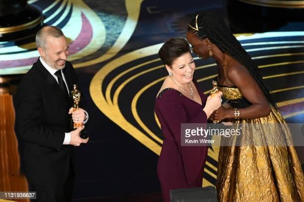 John Warhurst and Nina Hartstone accept the Sound Editing award for 'Bohemian Rhapsody' onstage from Danai Gurira during the 91st Annual Academy...