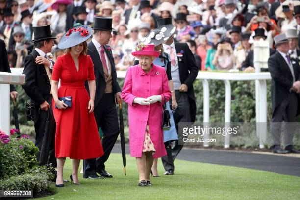 John Warren Princess Eugenie of York Prince Andrew Duke of York Queen Elizabeth II and Princess Beatrice of York are seen in the Parade Ring as they...