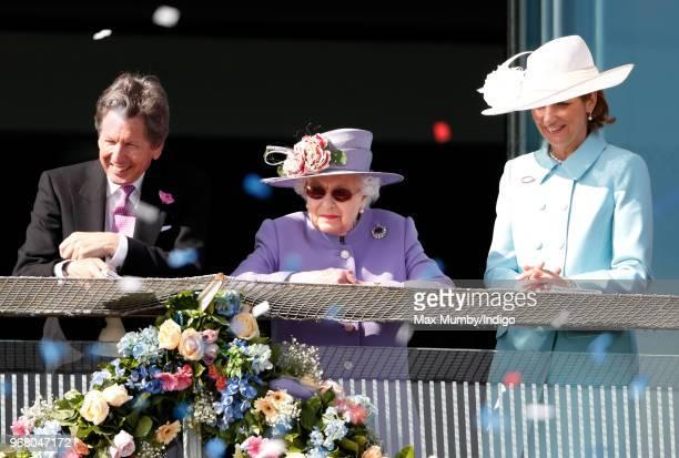 John Warren Queen Elizabeth II and Lady Carolyn Warren attend Derby Day of the Investec Derby Festival at Epsom Racecourse on June 2 2018 in Epsom...