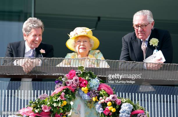 John Warren, Queen Elizabeth II and Lord Samuel Vestey watch the racing as they attend Derby Day during the Investec Derby Festival at Epsom...