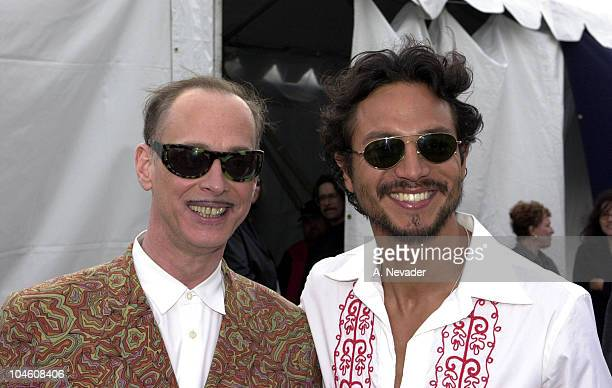 John Waters and Benjamin Bratt during The 17th Annual IFP/West Independent Spirit Awards Backstage at Santa Monica Beach in Santa Monica California...
