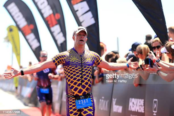 John Watkins reacts as he finishes the IRONMAN 703 Oceanside on April 06 2019 in Oceanside California