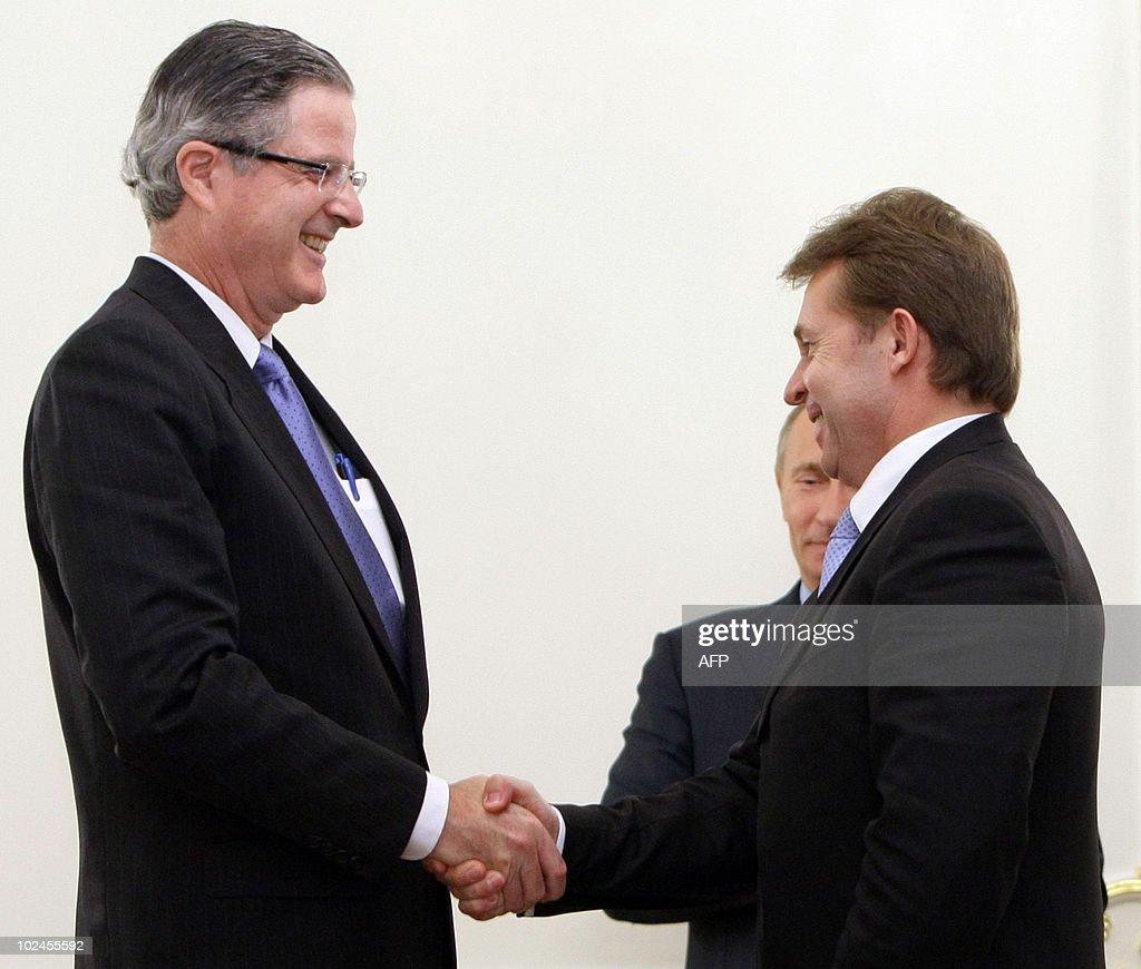 John Watson Chairman And Ceo Of Chevron Corporation L Sergei Bogdanchikov