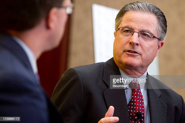 John Watson chairman and chief executive officer of Chevron Corp speaks during an interview at the American Petroleum Institute energy jobs summit on...