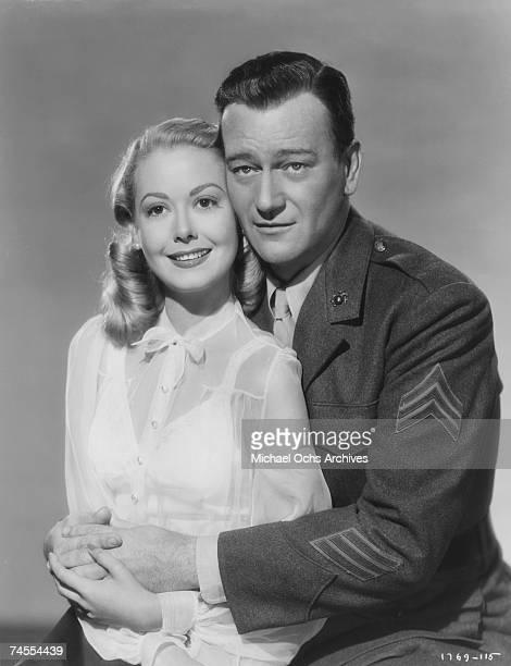 John Wayne and Adele Mara on the set of 'Sands Of Iwo Jima' directed by Allan Dwan circa 1949 in Los Angeles California