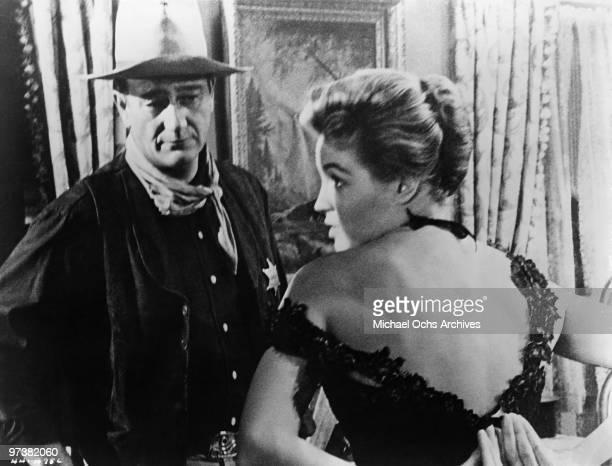 John Wayne and Angie Dickinson on the set of the movie 'Rio Bravo' in 1959 in Tucson, Arizona.