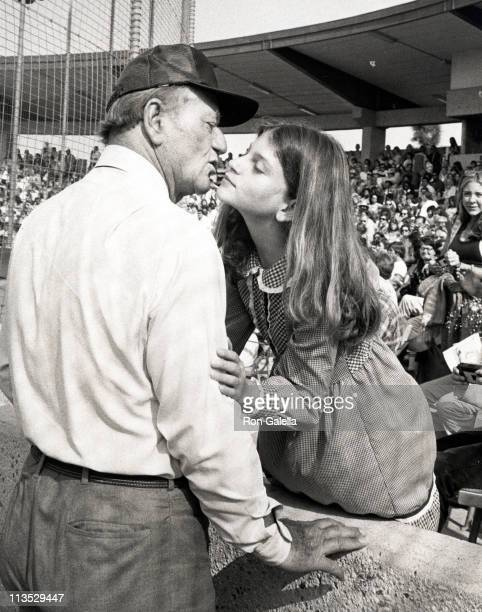 John Wayne And Daughter Marissa Wayne during Celebrity Baseball Game April 17 1977 at USC in Los Angeles CA United States