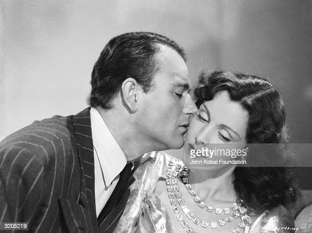John Wayne and Frances Dee star as Lynn Hollister and Sabra Cameron in 'A Man Betrayed' directed by John H Auer for Republic Pictures Corporation