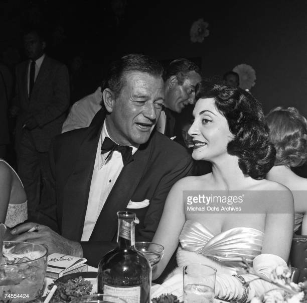 John Wayne and his future wife Pilar attend a premiere party for The High And The Mighty on May 27 1954 at the Mocambo nightclub in Los Angeles...
