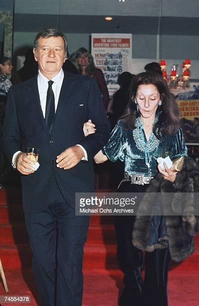 John Wayne and his wife Pilar at a movie premiere circa 1971 in Los Angeles California