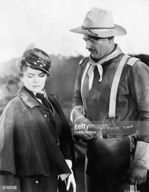John Wayne and Joanne Dru as Captain Nathan Brittles and Olivia Dandridge respectively in a scene from the RKO western 'She Wore a Yellow Ribbon'...