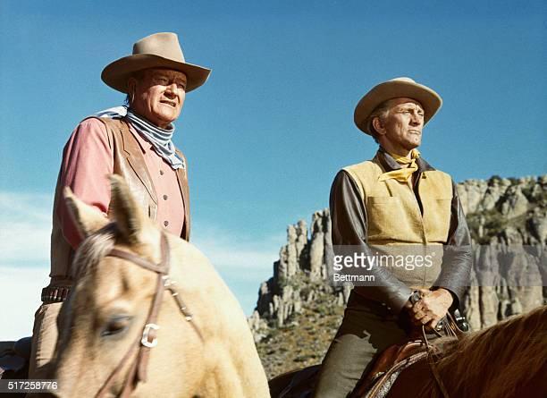 John Wayne and Kirk Douglas on horseback in the 1967 film The War Wagon
