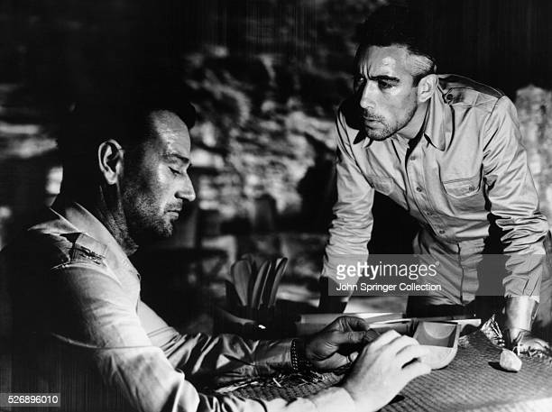 John Wayne as Colonel Joseph Madden and Anthony Quinn as Captain Andres Bonifacio in the 1945 film Back to Bataan