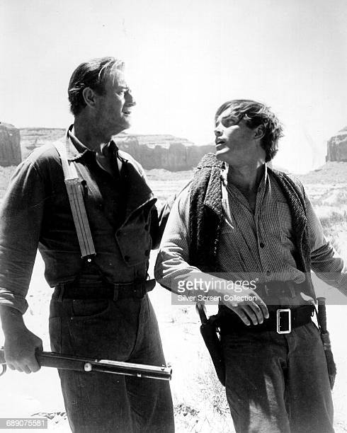 John Wayne as Ethan Edwards and Jeffrey Hunter as Martin Pawley in the western 'The Searchers' directed by John Ford 1956