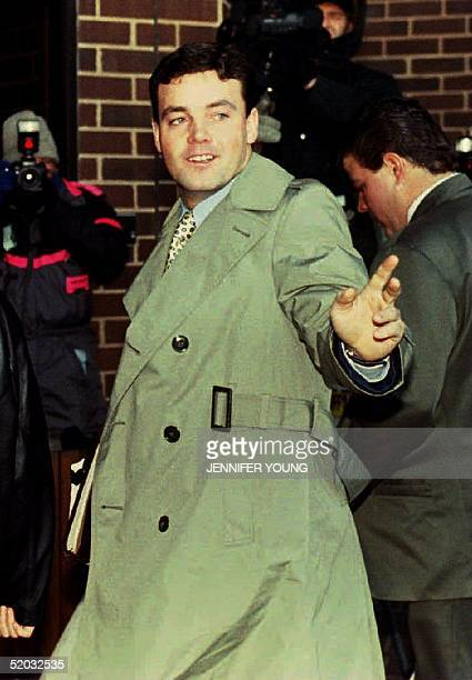 John Wayne Bobbitt points toward photographers as he arrives at the Prince William County Courthouse in Manassas VA 18 January 1994 for the fifth day...