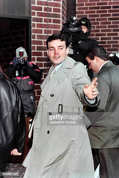 John Wayne Bobbitt points toward photographers as he arrives at the Prince William County Courthouse in Manassas on January 18 1994 for the fifth day...