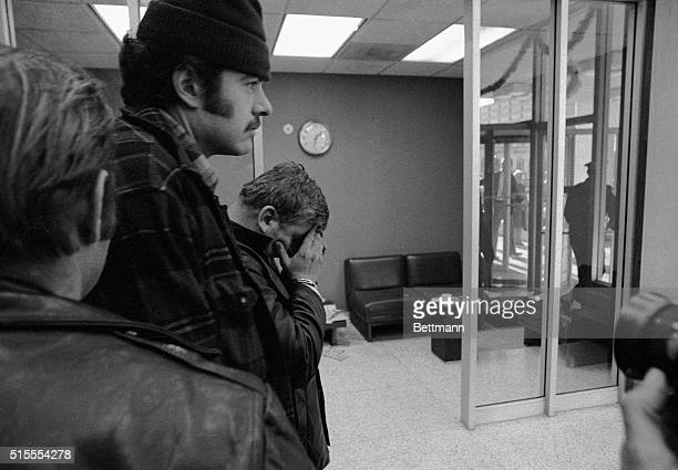 John Wayne Gacy a convicted sex offender who liked to wear a clown suit at children's parties covers his face as he is led to a courtroom 12/22 by a...