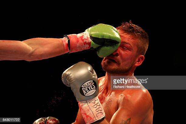 John Wayne Hibbert takes a punch from Andrea Scarpa of Italy during their Vacant WBC Silver SuperLightweight Championship fight at The O2 Arena on...
