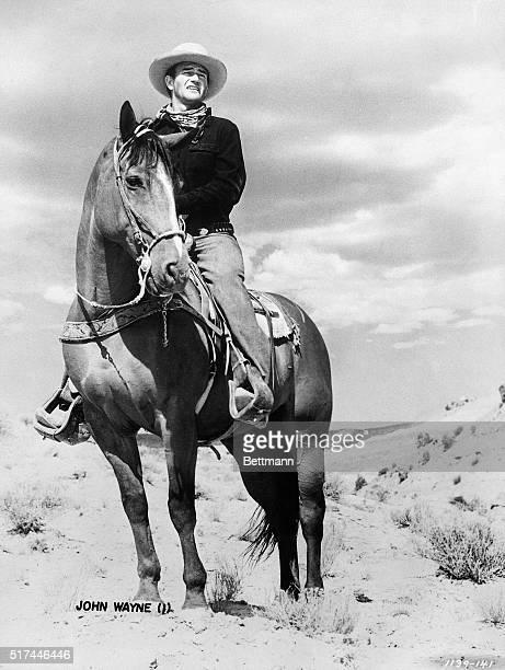 John Wayne in a scene from a western movie Undated film still