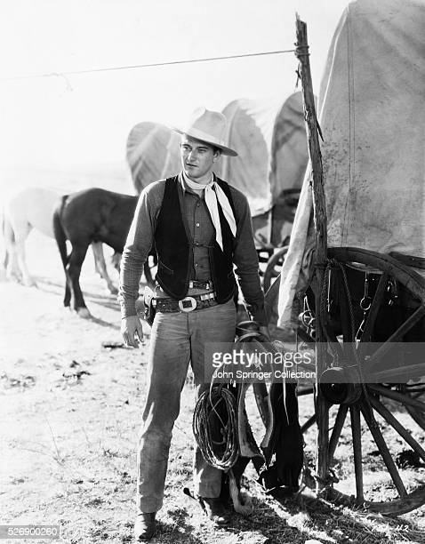 John Wayne in a scene from the movie The Big Stampede 1932 Wayne shown here holding saddle