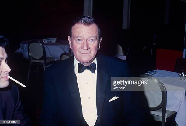 John Wayne in a tux at a table circa 1970 New York