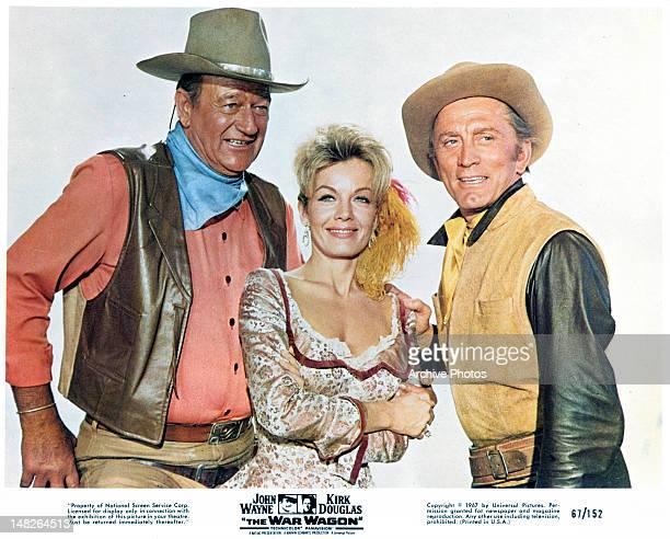 John Wayne Joanna Barnes and Kirk Douglas publicity portrait for the film 'The War Wagon' 1967