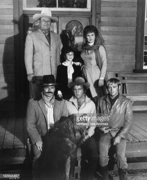 John Wayne John Ethan Wayne Maureen O'Hara and Patrick Wayne Bobby Vinton and Chris Mitchum pose for a family portrait in a scene from the movie Big...