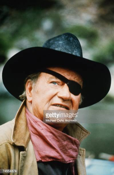John Wayne on the set of Rooster Cogburn directed by Henry Hathaway circa 1975 at the Rogue River in the counties of Josephine and Curry west of the...