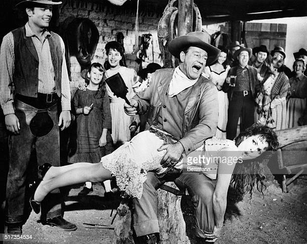 John Wayne playing George McLintock spanks Maureen O'Hara playing his wife Katherine in the Westerncomedy McLintock