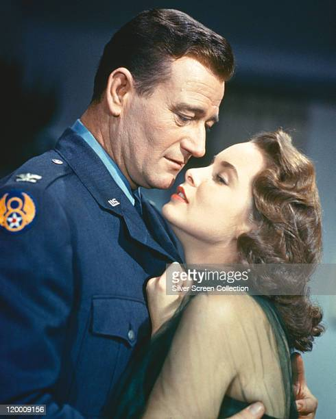 John Wayne , US actor, in an US Air Force unform, embracing Janet Leigh , US actress, in publicity still issued for the film, 'Jet Pilot', 1957. The...
