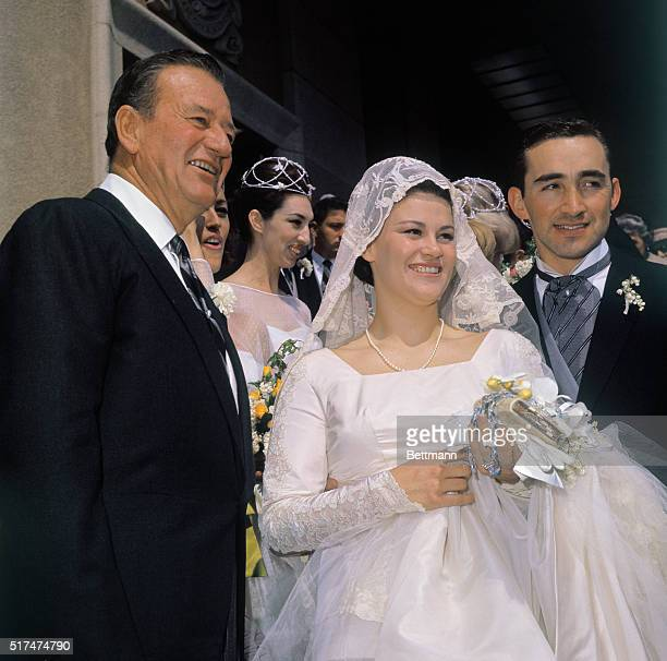 John Wayne with daughter Melinda Ann on her wedding day to Gregory Robert Munoz The three are posing on the steps of Blessed Sacrament Church