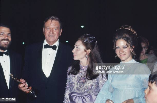 John Wayne with his wife Pilar and daughter at the Academy Awards after winning the best actor Oscar for True Grit on April 7 1970 in Los Angeles...