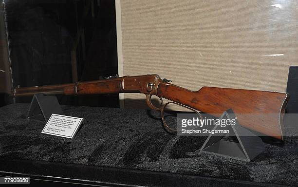 John Wayne's rifle is displayed at AMPAS presents the premiere of the restored 3D classic 'Hondo' at the Samuel Goldwyn Theater November 13 2007 in...