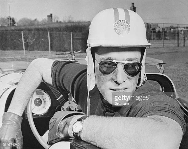 John Weitz noted both as a sportscar racer and fashion designer relaxes after a practice spin in the Morgan racer he will drive in the Sebring world...