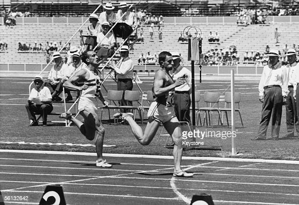 John Wenk of Scotland wins the second heat of the 880 yards event ahead of MA Fleet of England at the British Empire and Commonwealth Games Perth...