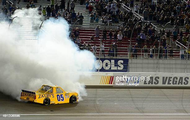 John Wes Townley driver of the Zaxby's Chevrolet celebrates after winning the NASCAR Camping World Truck Series Rhino Linings 350 at the Las Vegas...