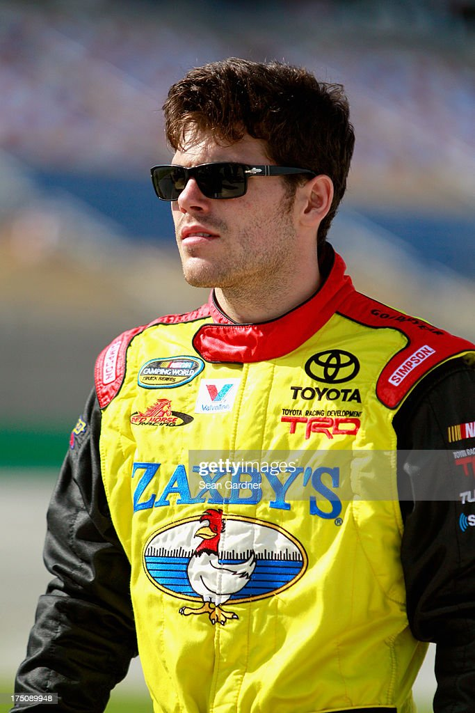 John Wes Townley, driver of the #7 Zaxby's Toyota, walks by the track during qualifying for the NASCAR Camping World Truck Series UNOH 225 at Kentucky Speedway on June 27, 2013 in Sparta, Kentucky.