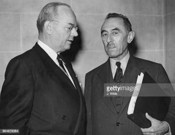 John Wesley Snyder Secretary of the United States Treasury talks to Camille Gutt Managing Director of the International Monetary Fund at the start of...